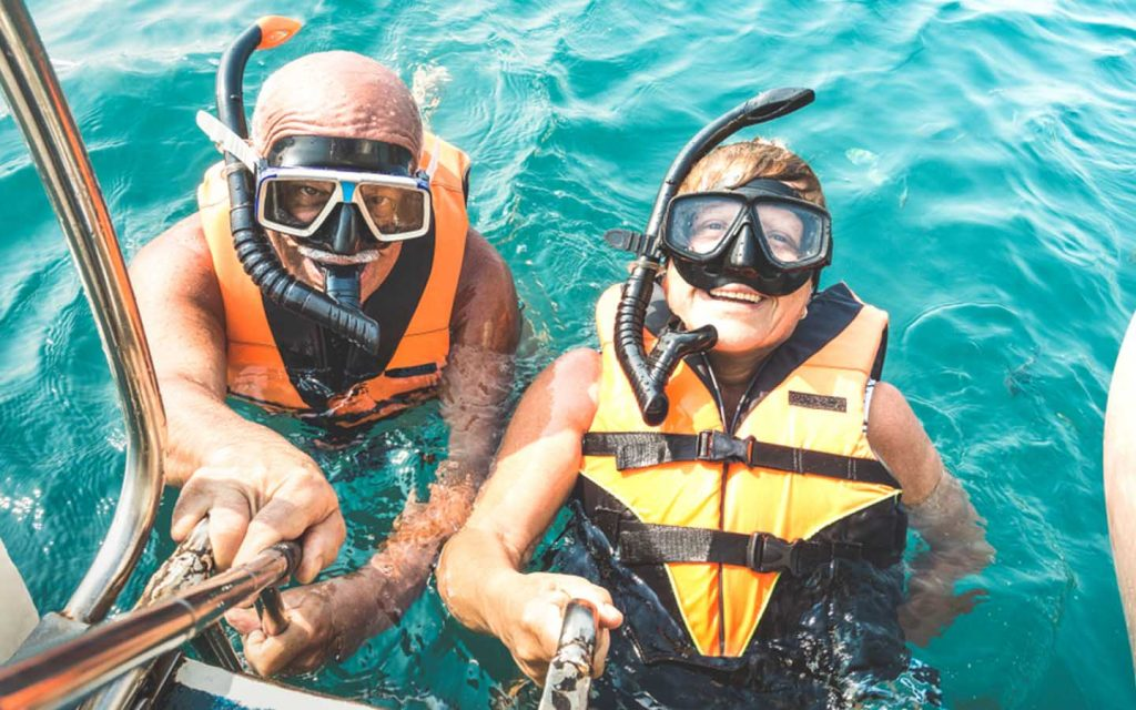 a couple is snorkelling