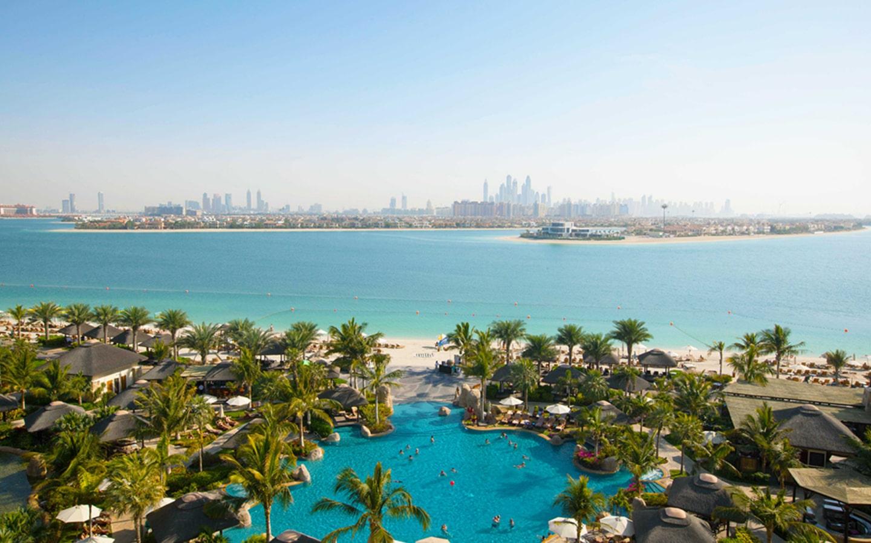 Aerial view of Sofitel the Palm Dubai private beach and pool