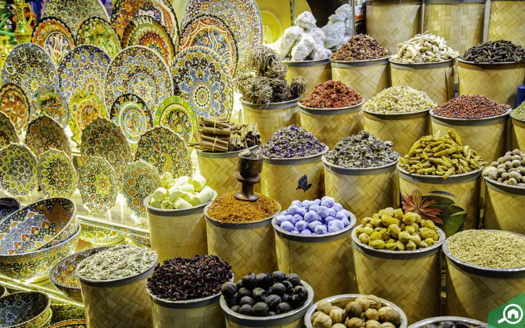 Different spices in baskets at the souk