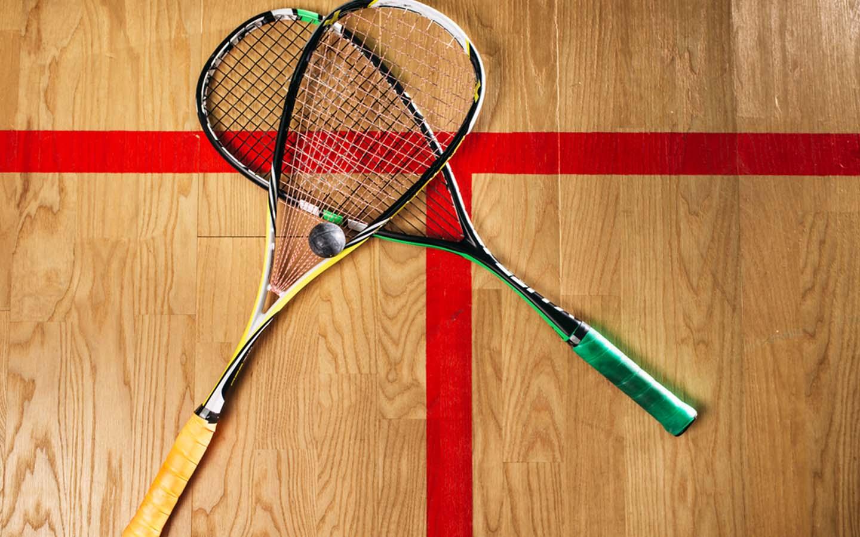 Squash rackets on the squash court floor