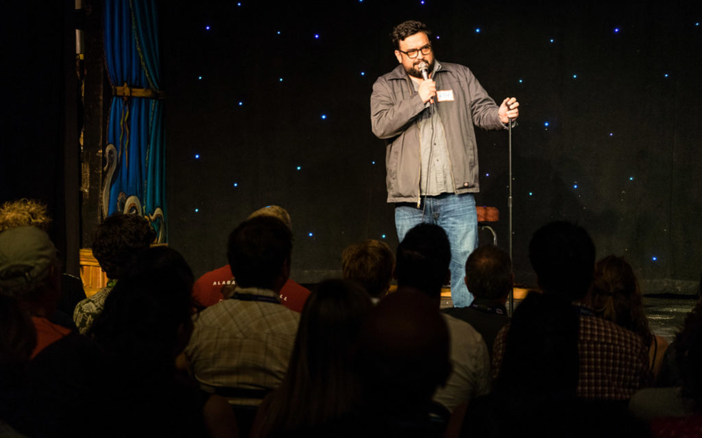 A comedian performing at the best comedy venues in Dubai
