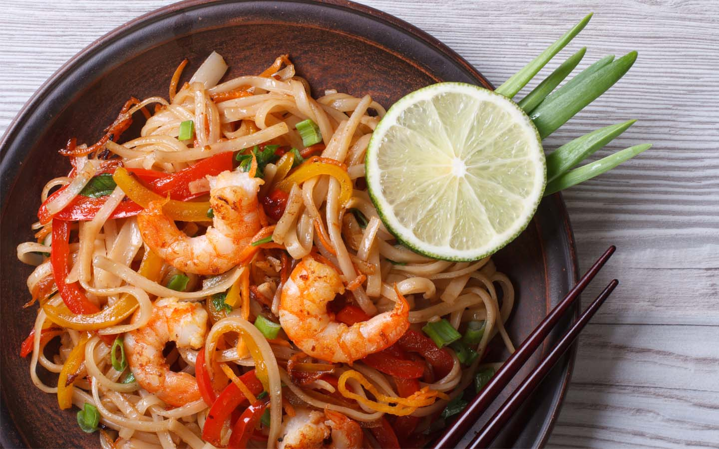 Asian rice noodles with shrimp and vegetables.