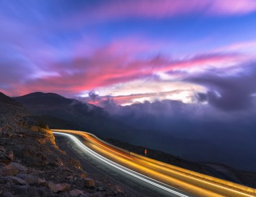 Sunrise at Jabal Jais Mountain with purple and blue sky shot with long exposition