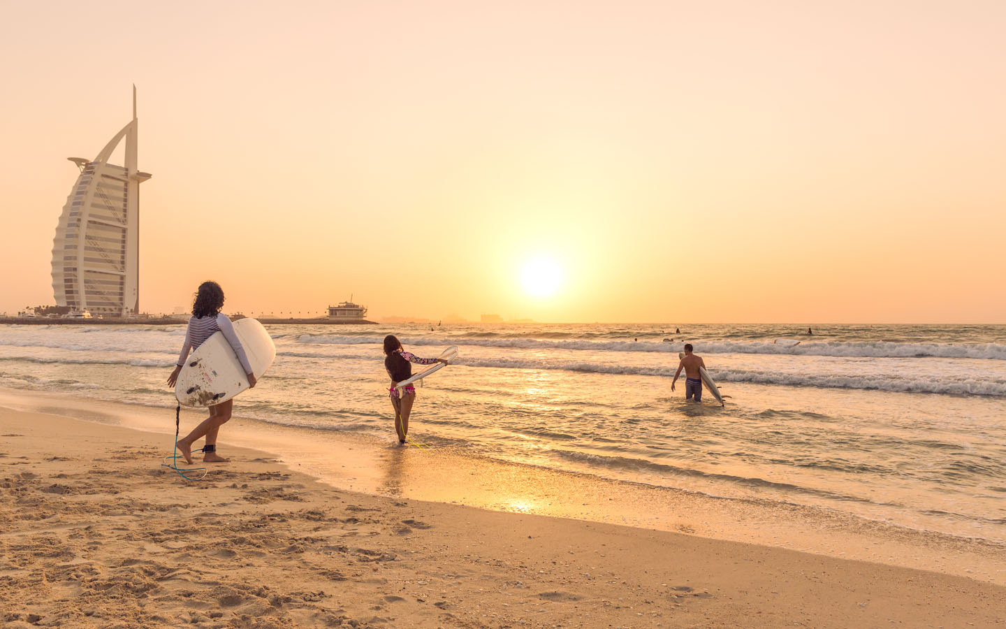 Surfers at Sunset Beach to catch a wave