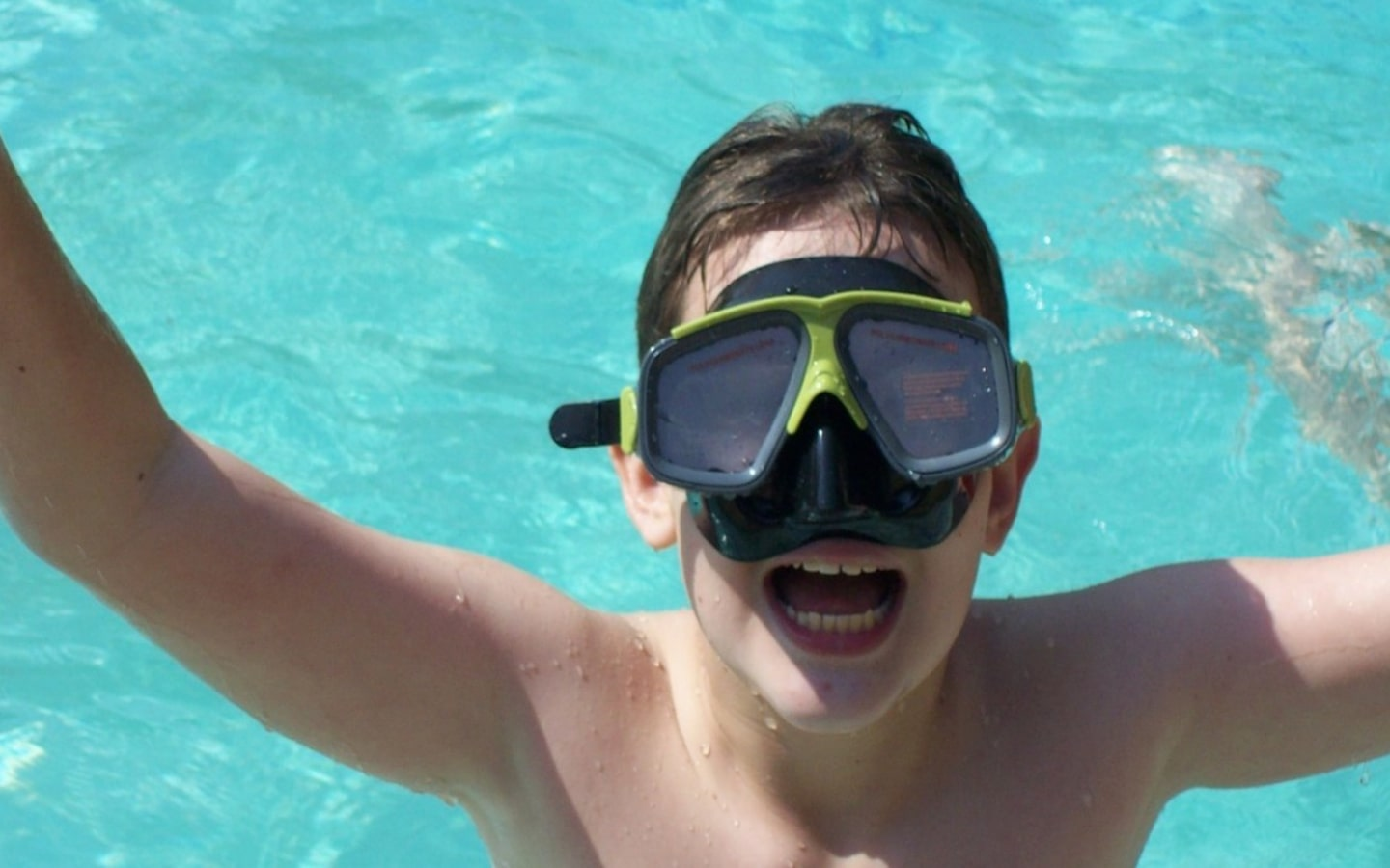 Boy swimming at fun summer camps in Palm Jumeirah