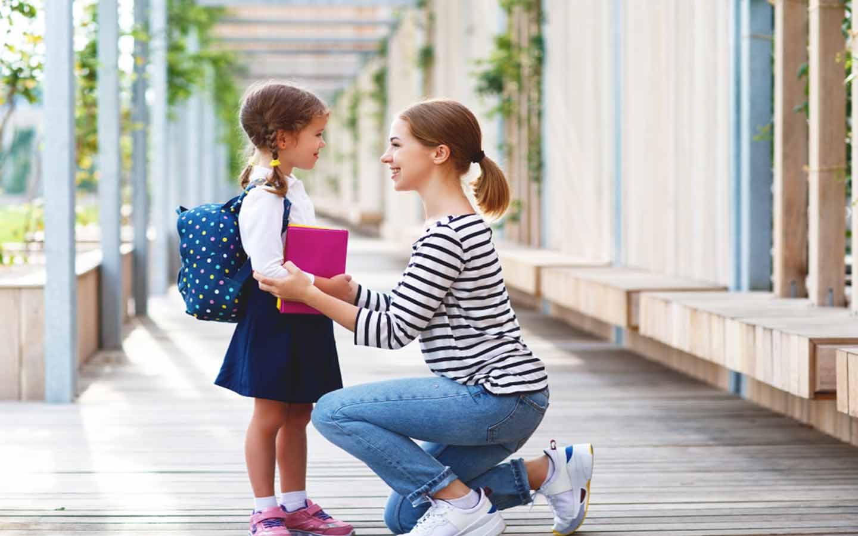 A teacher talking to a student