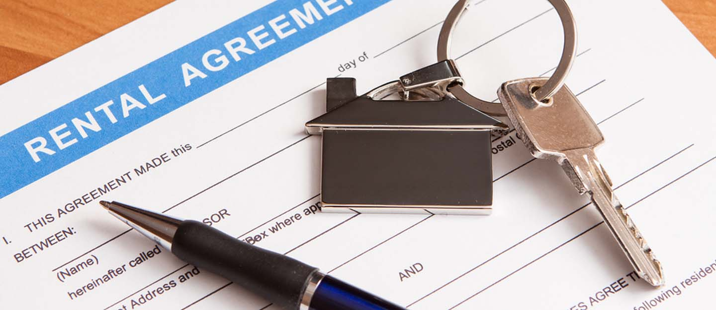Rental contract with a pen and keys