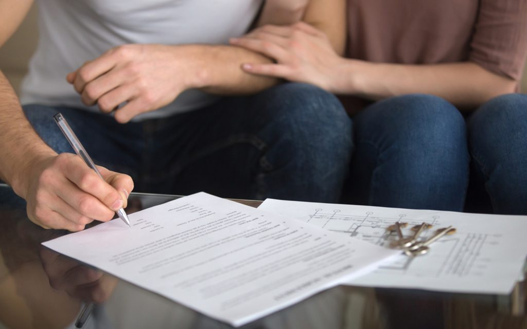 Couple looking at the Dubai tenancy contract terms and conditions