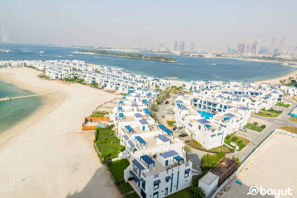 The view of a frond in Palm Jumeirah populated by beautiful blue and white villas