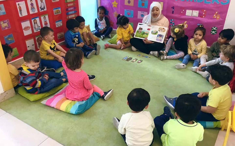 Children learning the art of storytelling at The Wonder Years Nursery in Dubai