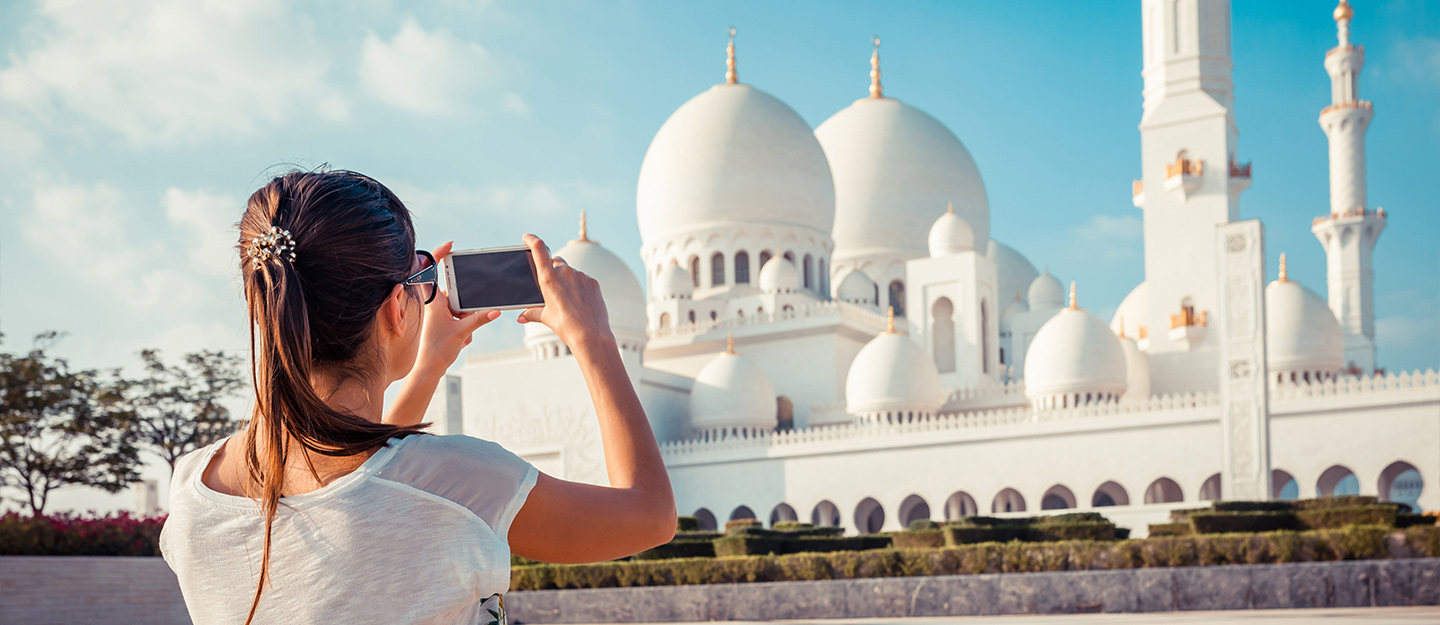 Woman takes photo of the Sheikh Zayed Mosque