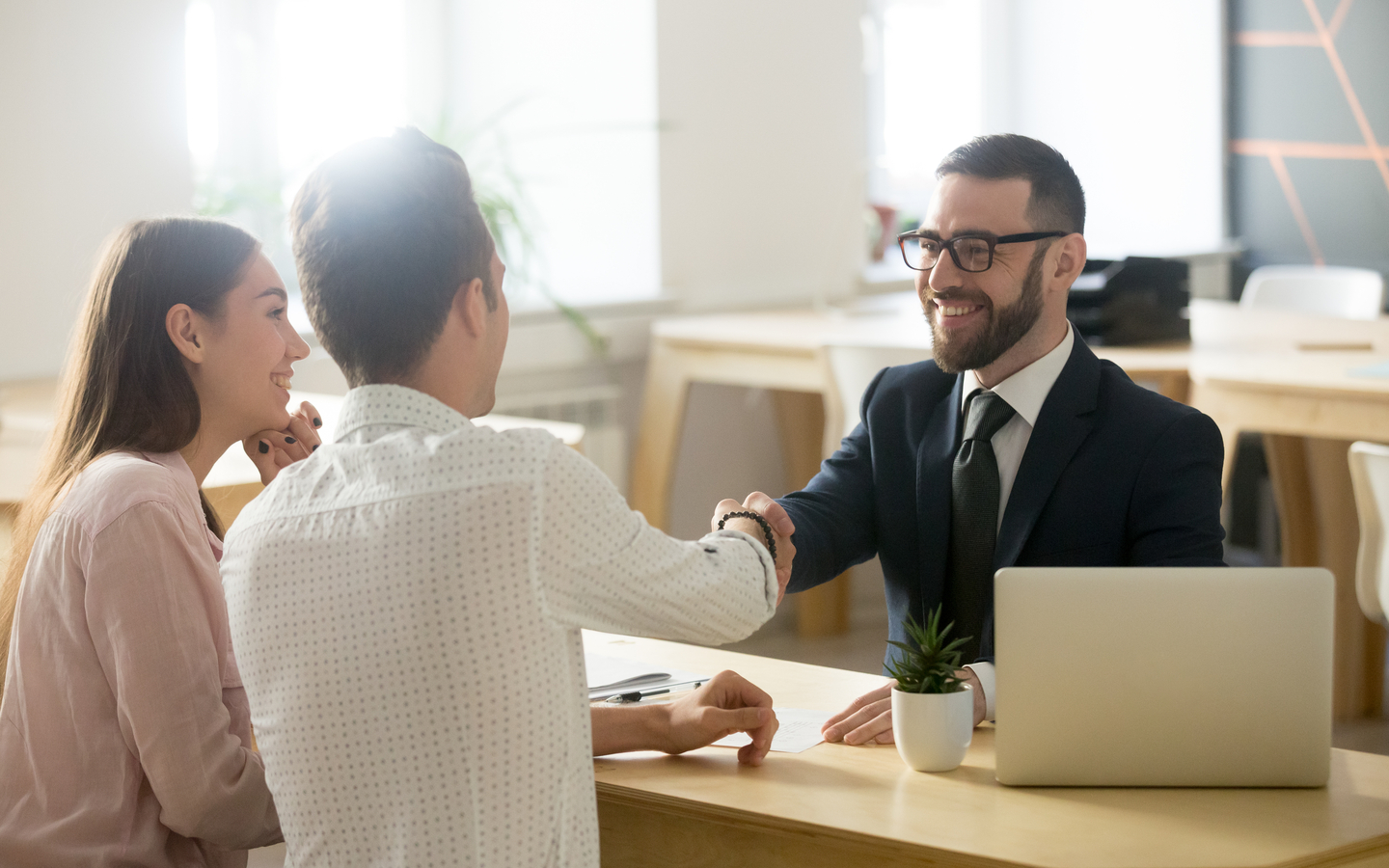 Real estate agent meets with sellers