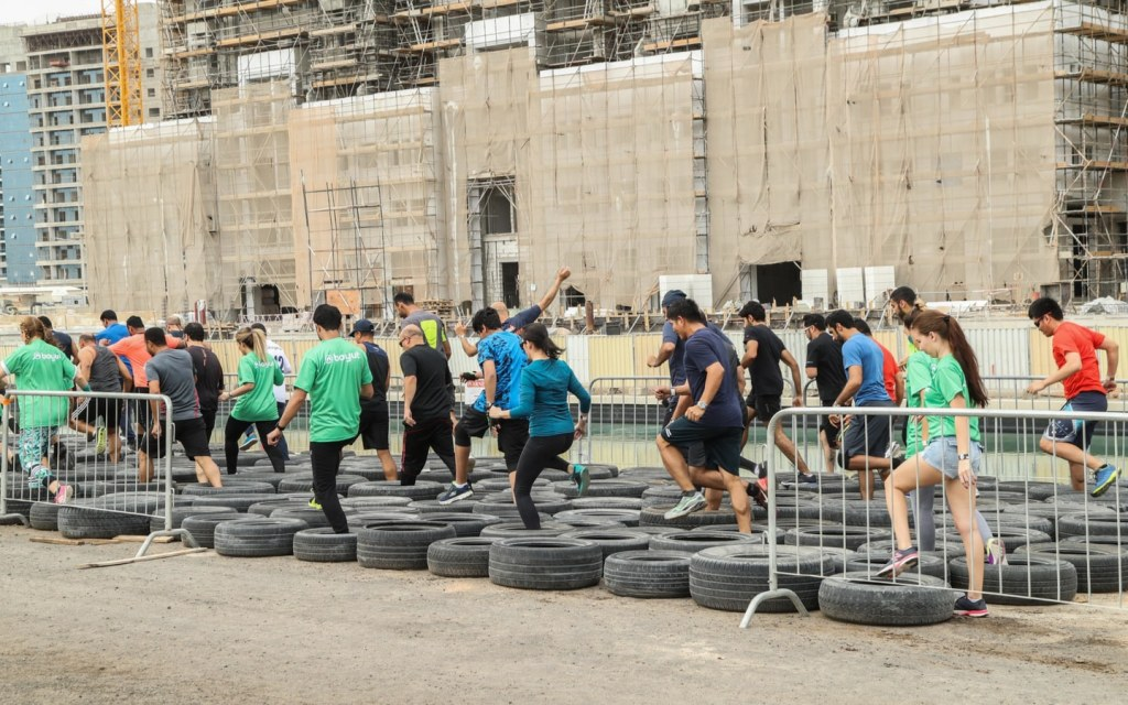 People completing the Tough Mudder obstacles 5K