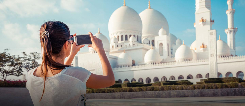 Tourist taking photo of Sheikh Zayed Mosque