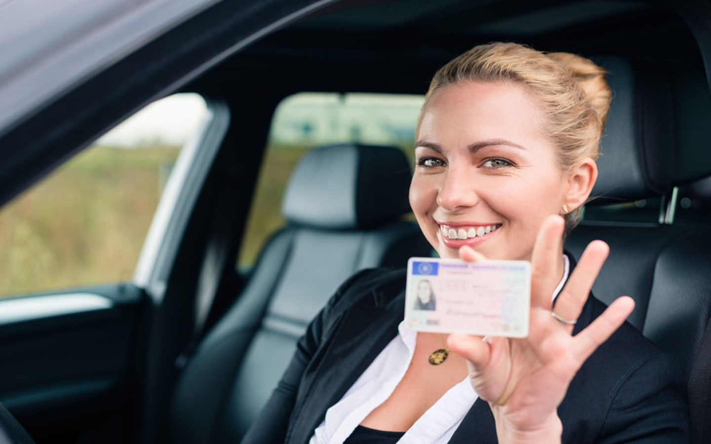 Tourist holding driver's license
