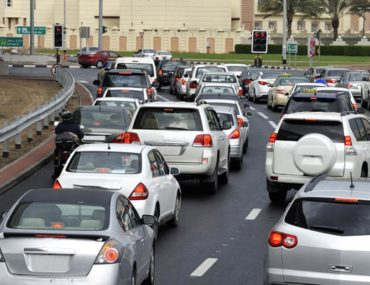 Cars stopping at a red light in Dubai