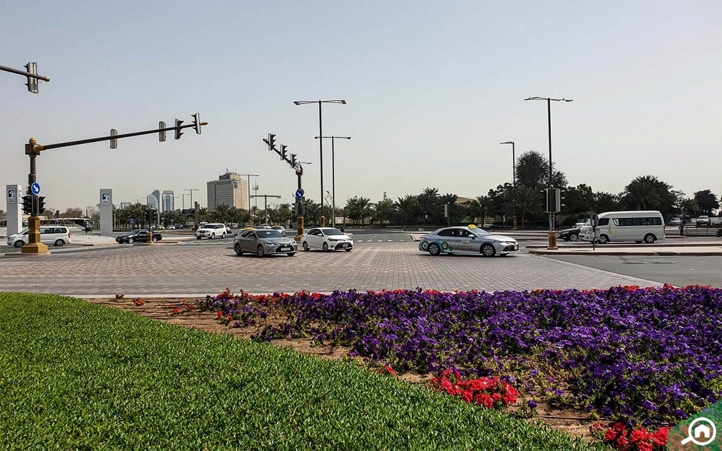 Traffic intersection in Abu Dhabi with cars and taxis