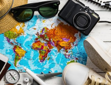Image showing world map with travel accessories