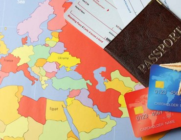 Travel concept with passports, tickets, and a map