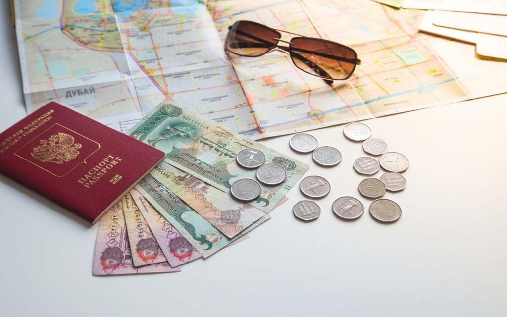UAE Dirhams and Passport