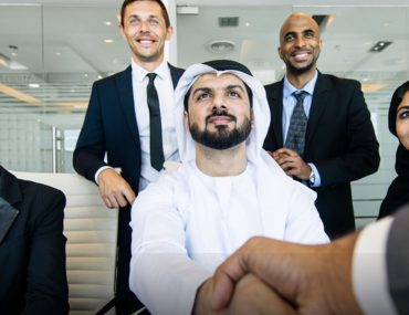 UAE employer shaking hands with new hire