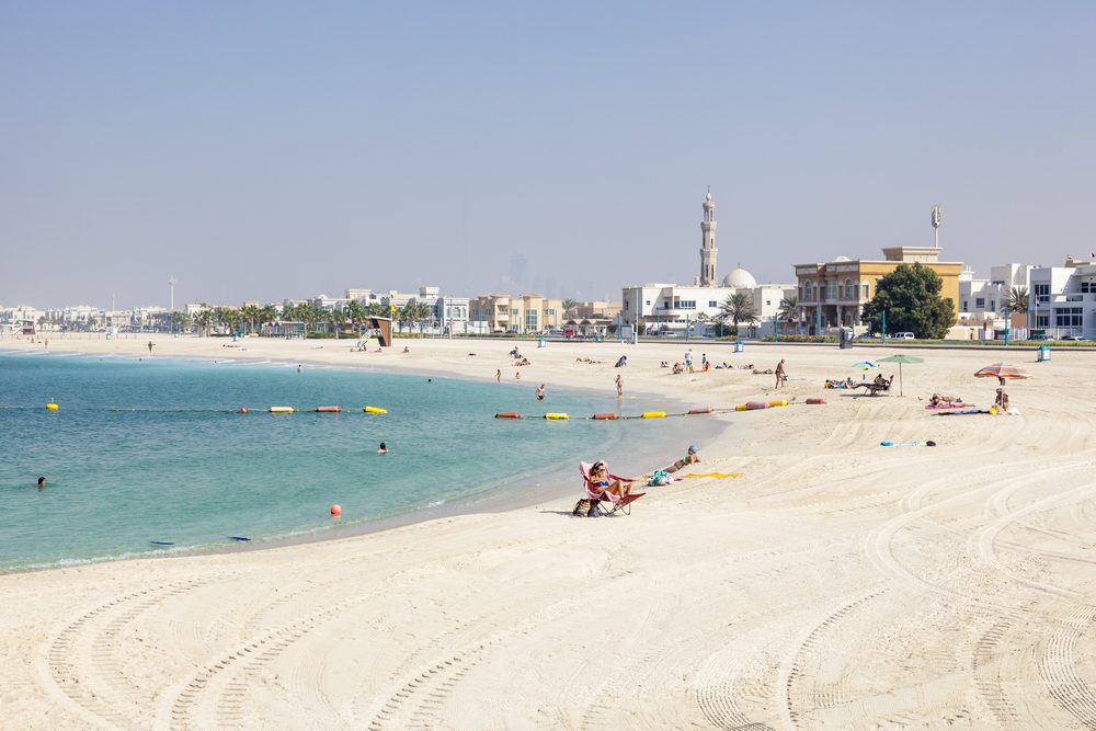 View of the pristine Umm Suqeim Beach with turquoise, crystal-clear waters of the Arabian Gulf