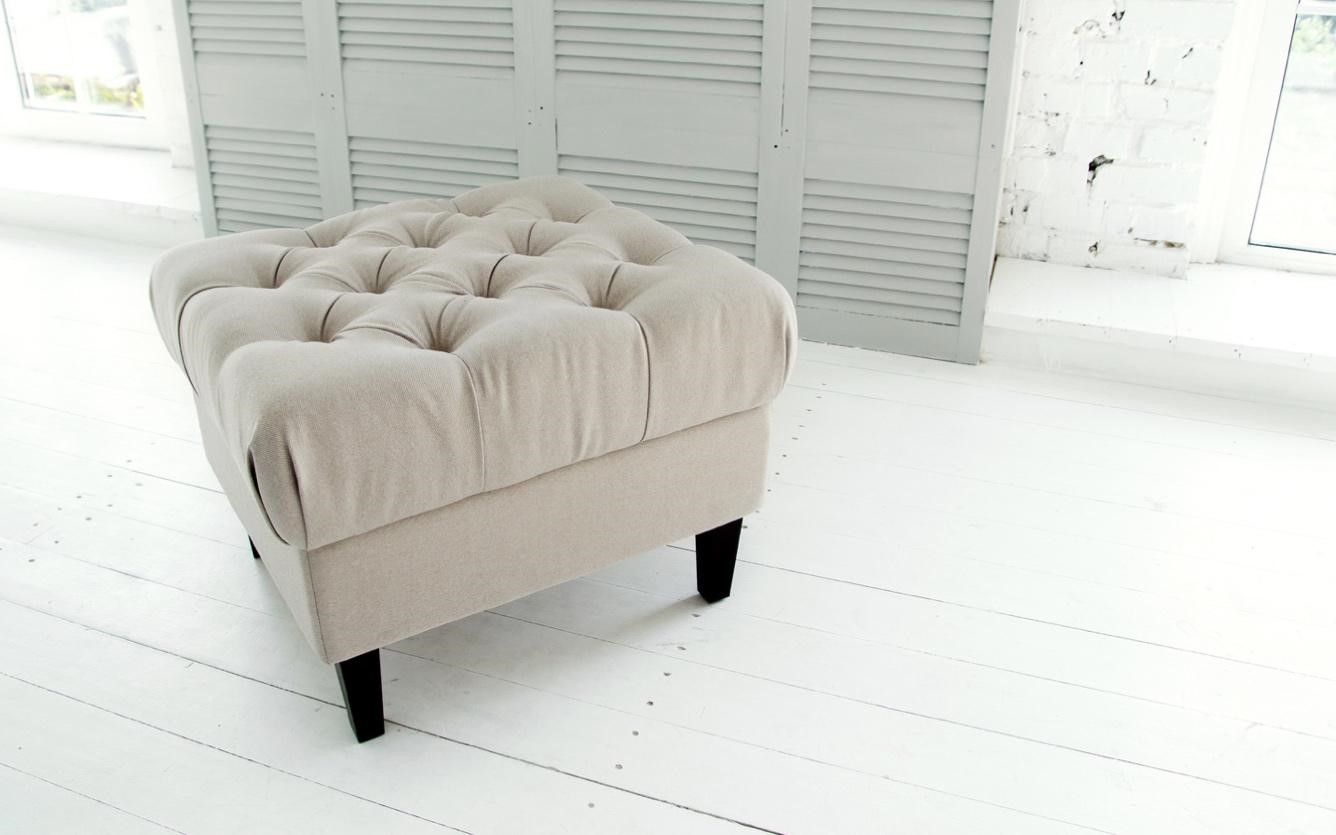 Off-white upholstered ottoman