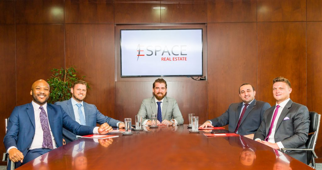 John Lyons, Head of Sales & Leasing - Espace Real Estate, with associates