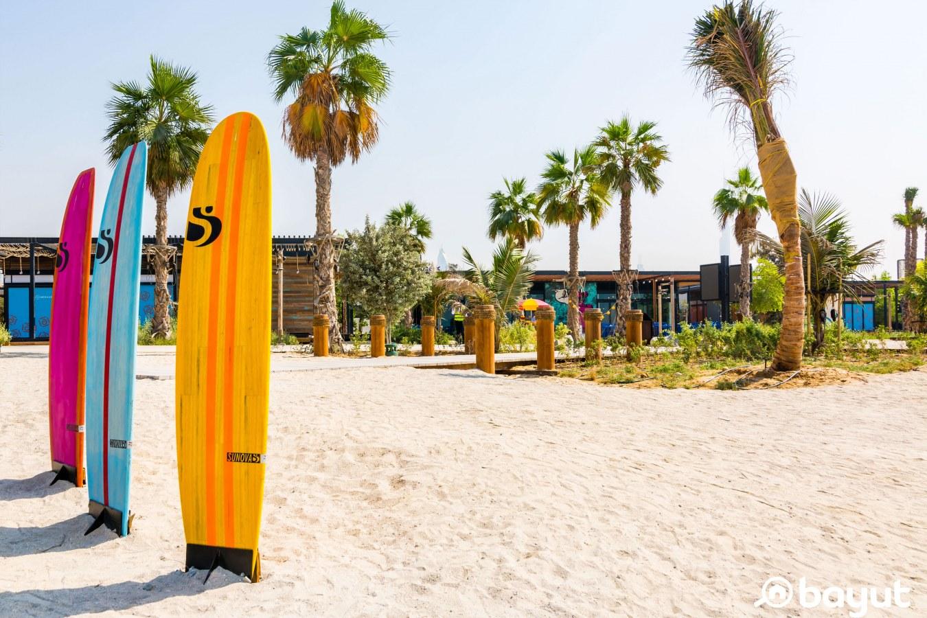 Three surf boards stuck in the sand at La Mer Beach Dubai