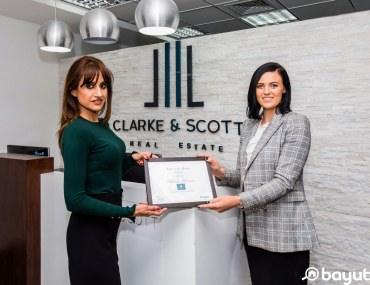 Bayut's Sales Director, Fibha Ahmed hands the Agent of the Month certificate to a high-score achieving Dubai Real Estate agent Hanna Robinson of Clarke & Scott
