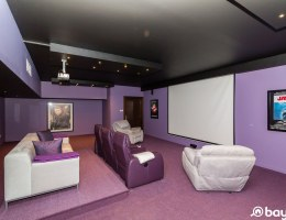 A purple cinema room with posters of Jaws and James Deen in an Al Barari villa for sale