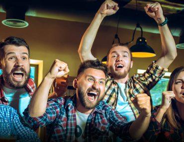 A group of friends watching English Premier League in Dubai