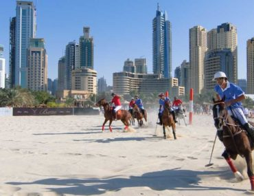 Group of men playing polo in Dubai