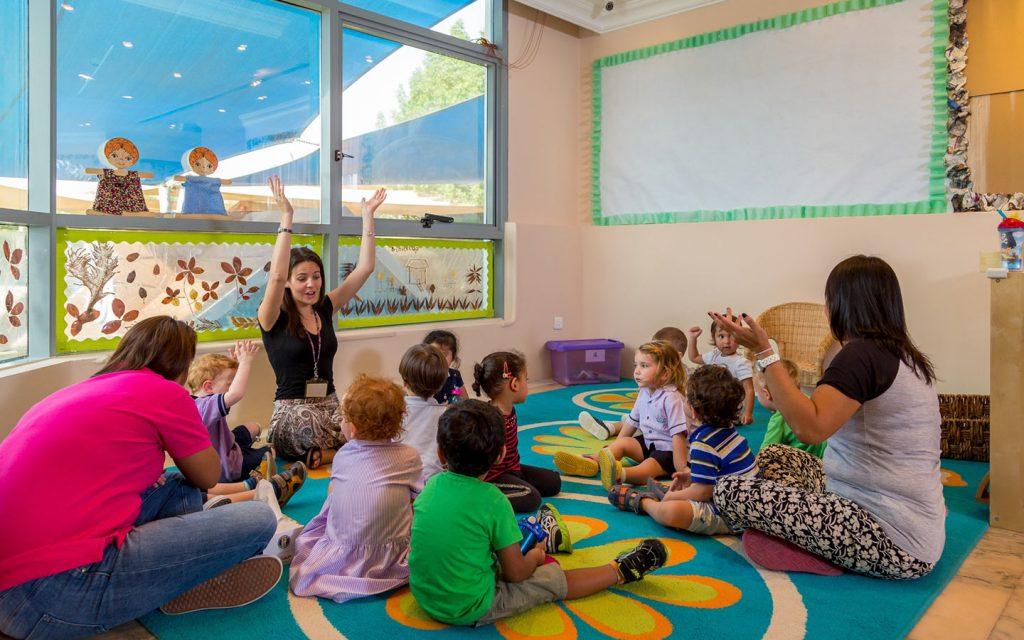 Teacher with students in Nursery school in Dubai Marina