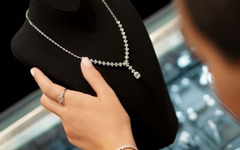 Woman inspecting diamond necklace