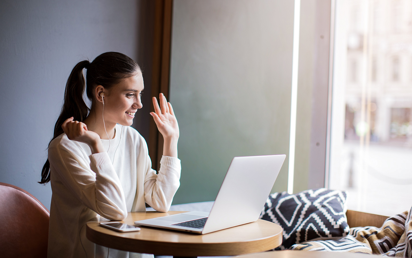 View of woman using internet calling plans in the UAE at home
