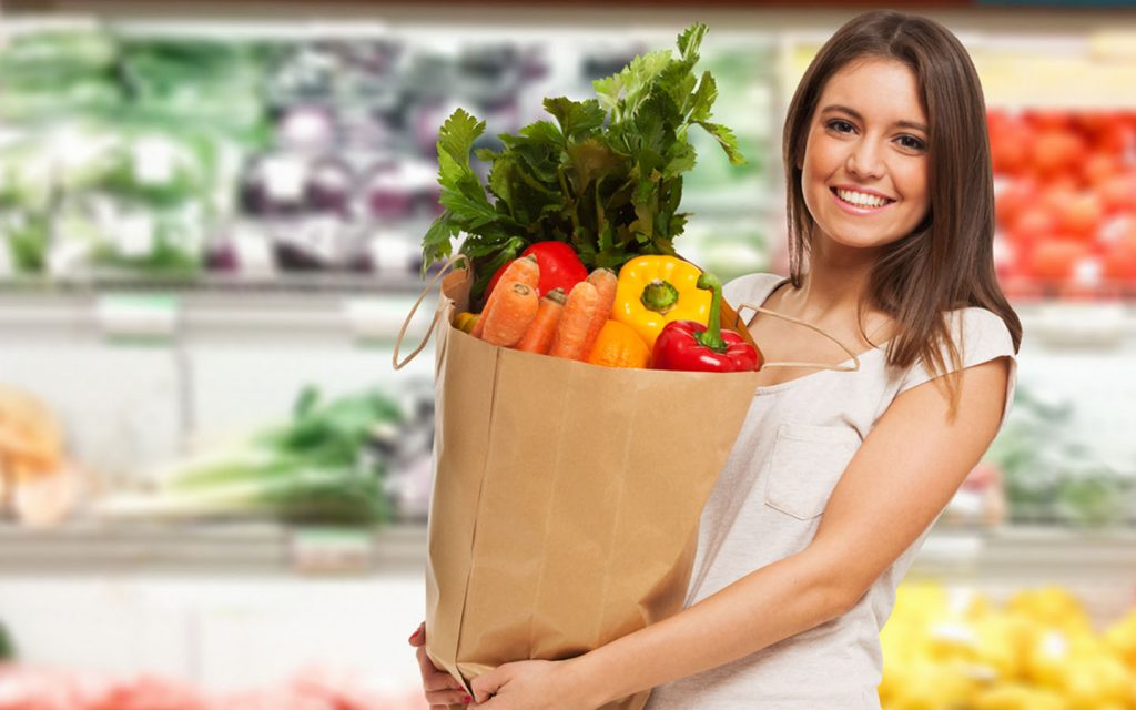 Woman with a bag of fresh vegetables