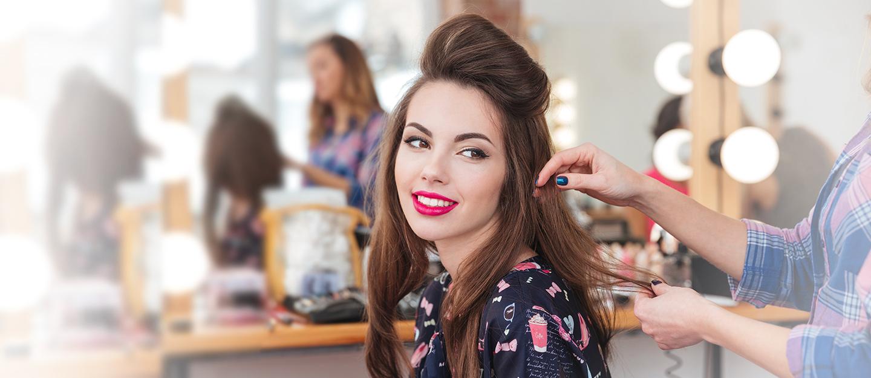 A women getting her hair styled in a Dubai Salon