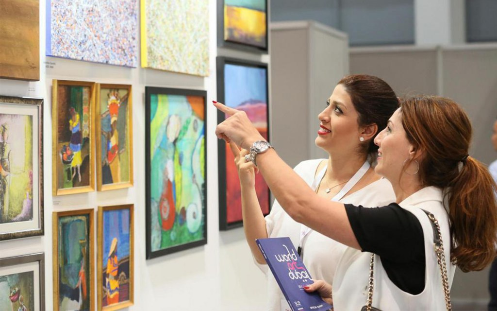 Two women in at art gallery at World Art Dubai