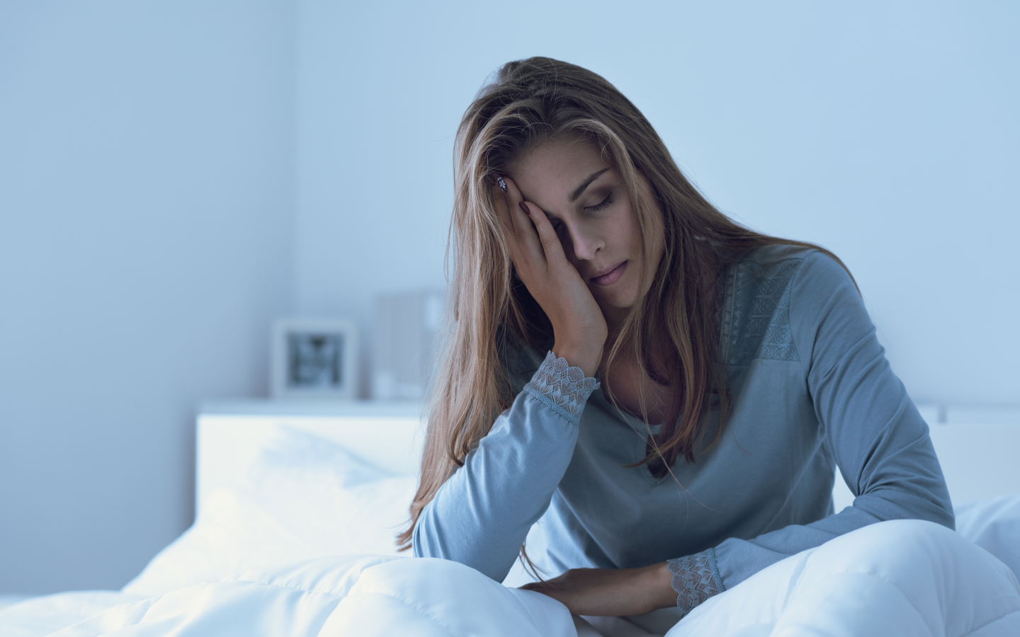 A depressed woman seems to have a headache