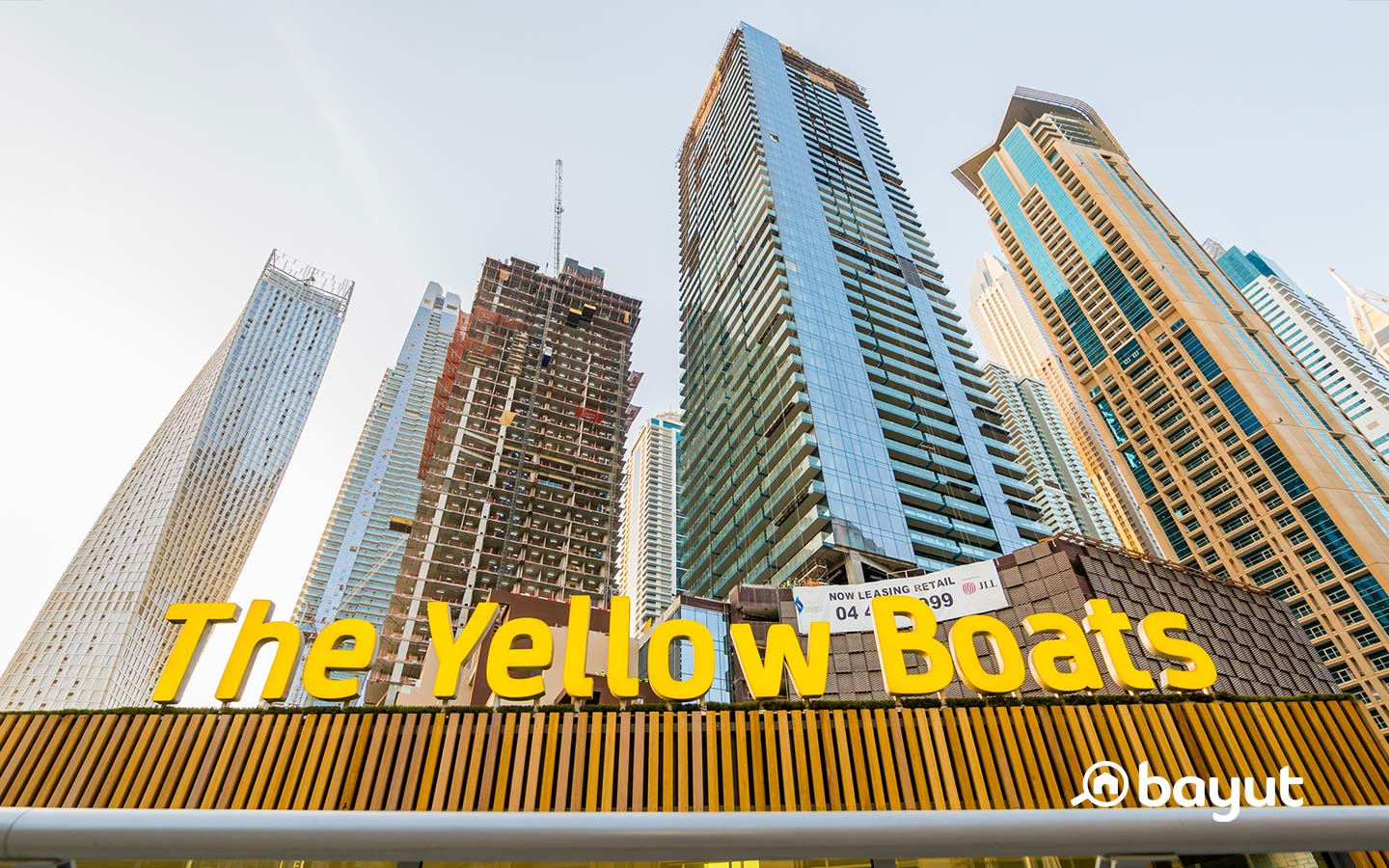 Singthsseing in Dubai Marina with Yellow Boats