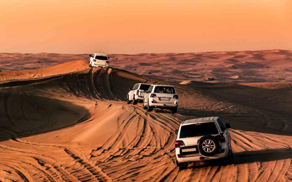 Fleet of cars driving in desert