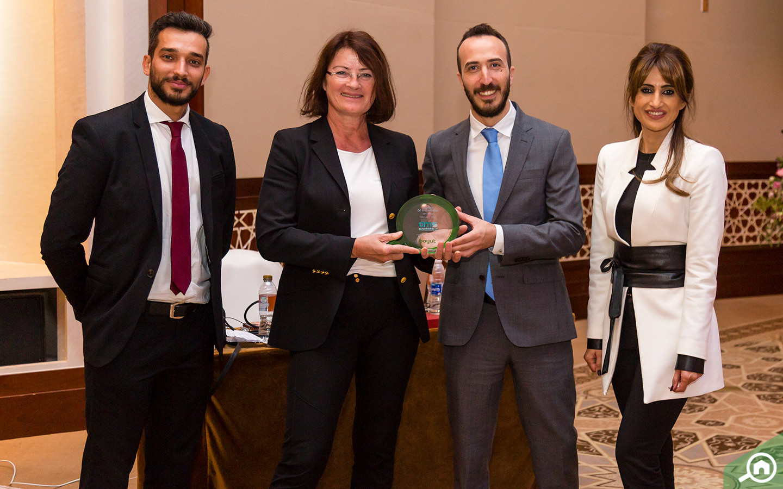 Monika Benning from AMS receiving the award