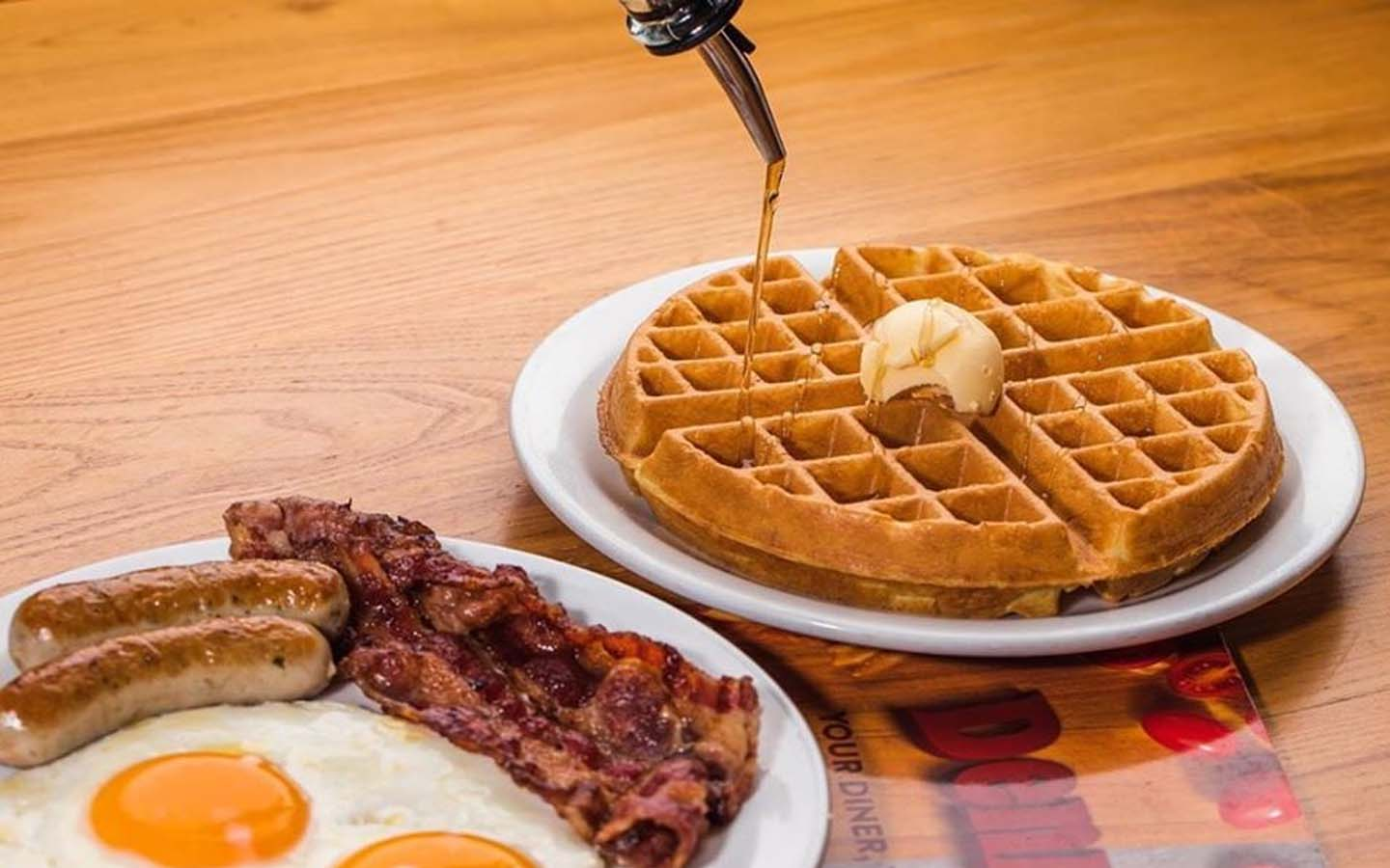 waffles, ham, eggs and sausages breakfast platters