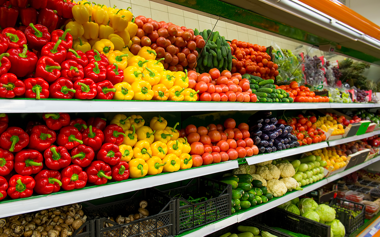 Fruits and vegetables in a shelf at a supermarket