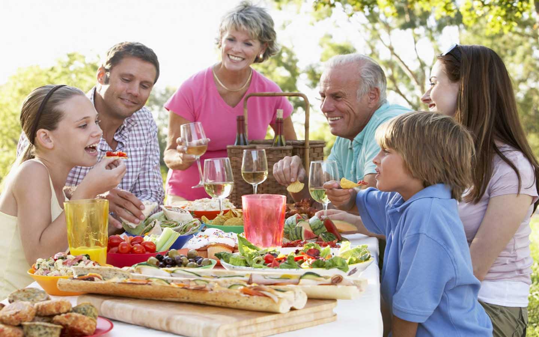 Family enjoying food in an al fresco setting
