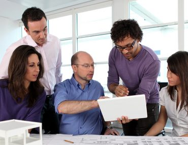 Architects in Dubai working together discussing a floor plan