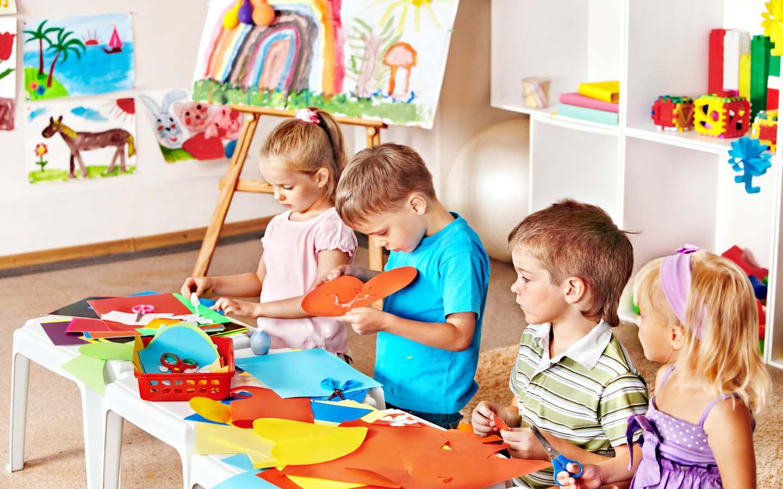 Kids indulging in artistic activities at a preschool