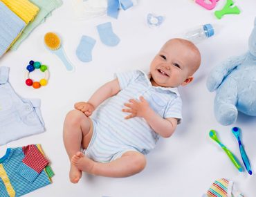 Baby with toys and decorative items