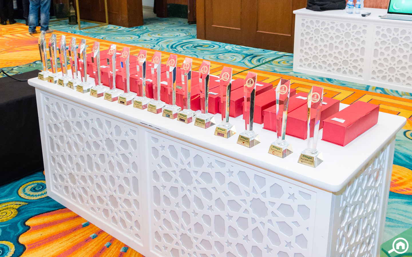 The trophies of the Golden Circle Award lined up to be given away to Dubai real estate agencies.